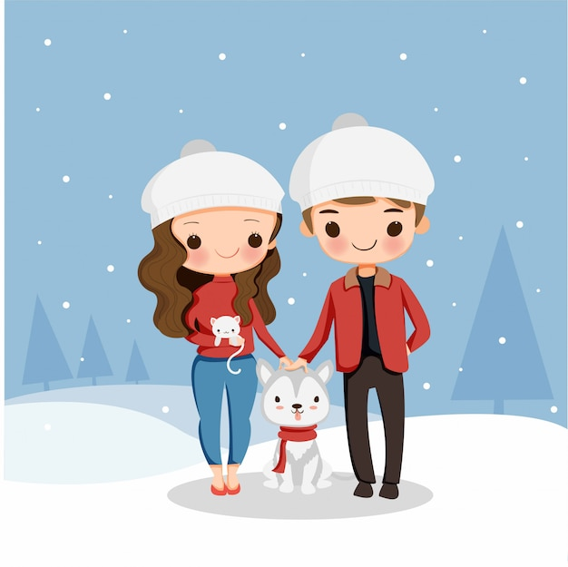 Cute boy and girl with dog and cat enjoy playing snow on christmas holiday