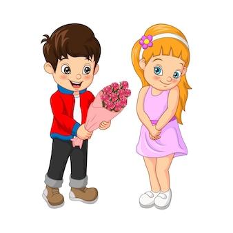 Милый мальчик дарит девушке прекрасный букет цветов