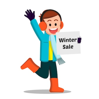 Cute boy holding a piece of paper for winter sale