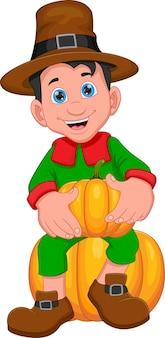 Cute boy holding pumpkin on white background