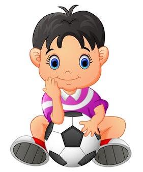 Cute boy holding a soccer ball
