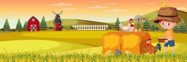 일몰 시간에 자연 농장 가로 풍경 장면에서 귀여운 소년