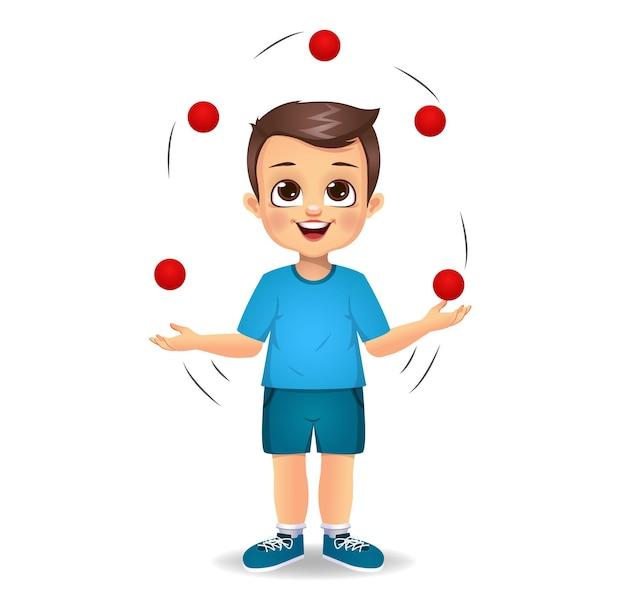 Милый мальчик ребенок играет жонглирование
