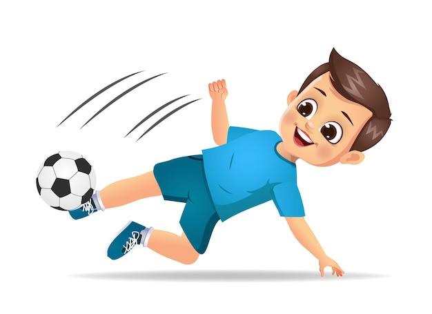 サッカーをしているかわいい男の子の子供