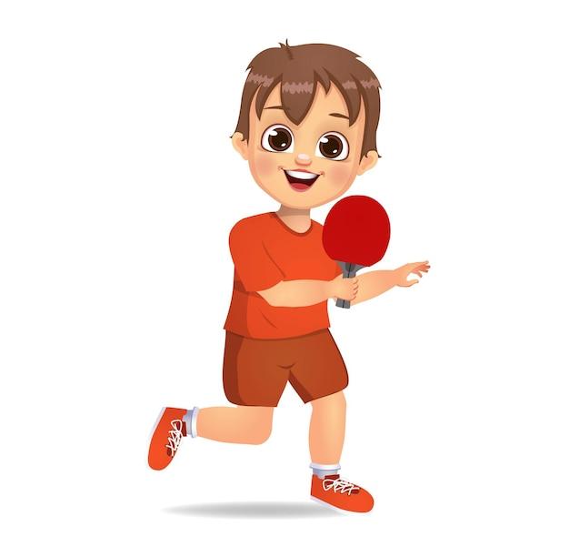 Милый мальчик ребенок играет в настольный теннис