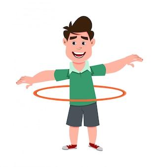 Cute boy playing hula hoop