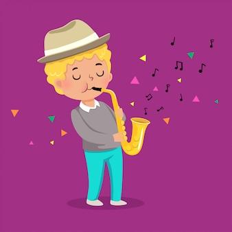 Милый мальчик играет на саксофоне