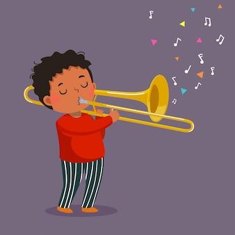 Милый мальчик играет на тромбоне