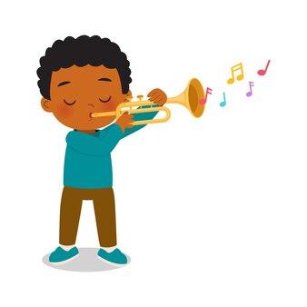 Милый мальчик играет на трубе