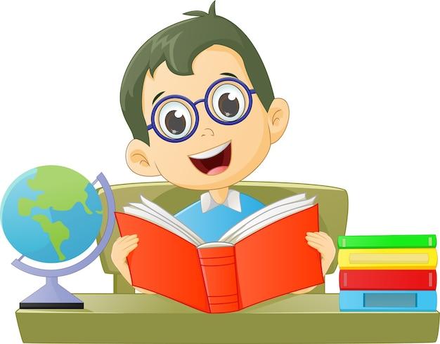 Cute boy reading a book