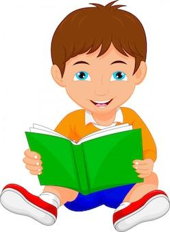 Cute boy reading book