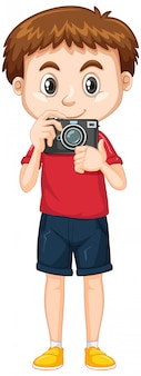 Cute boy in red shirt holding camera on white