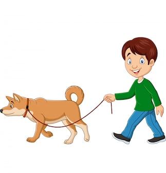 Милый мальчик гуляет с собакой