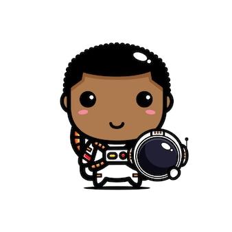 우주 비행사 의상을 입고 귀여운 소년