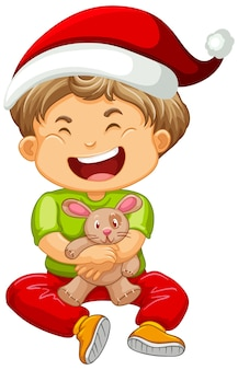 Cute boy wearing christmas hat and playing with his toy