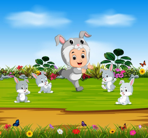 Cute boy wearing costume rabbit and play with rabbits