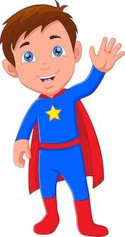 スーパーヒーローの衣装を着て手を振っているかわいい男の子