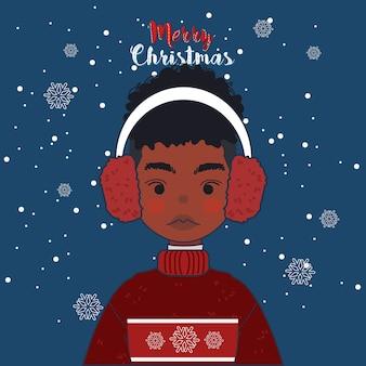 Милый мальчик носить свитер и наушники в рождество зимой.