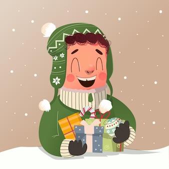 녹색 겨울 코트를 입은 귀여운 소년은 크리스마스 이브를 축하하고 많은 선물을 받았습니다