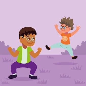 Симпатичные мальчики прыгают в траве