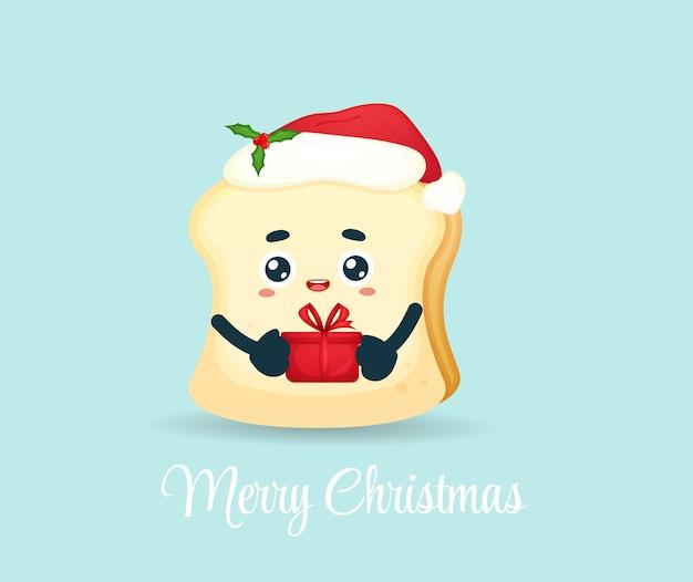 Милый хлеб с подарком в шляпе санта-клауса на рождество premium векторы