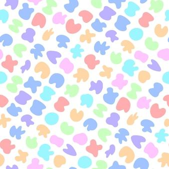 カラフルなパステルスポットの染みとかわいい明るい子供っぽいシームレスパターン甘い繊細な背景
