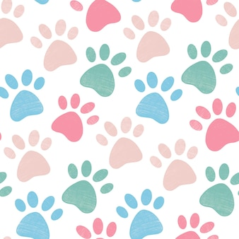 Cute bright seamless pattern with crayon pencil textured animal pet paw in pastel colors