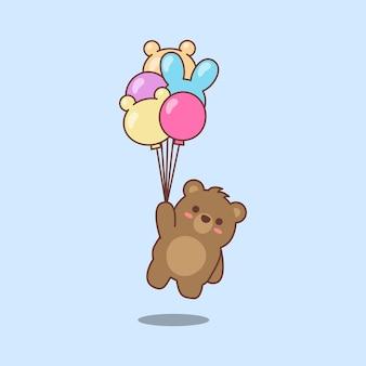 풍선 그림을 들고 귀여운 갈색 곰