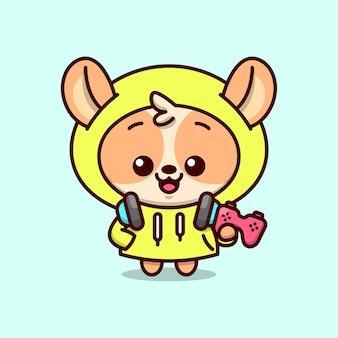 빨간색 조이스틱을 들고있는 파란색 헤드폰이 달린 노란색 후디 재킷에 귀여운 갈색 강아지