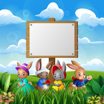 Cute bunnies with easter background and blank sign
