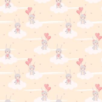 Милый зайчик и воздушный шар в форме сердца бесшовные модели.
