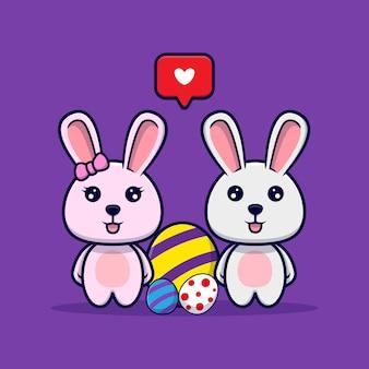 かわいいウサギのカップルとイースターの日の装飾的な卵