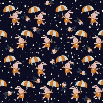 傘のシームレスなパターンで踊るかわいいウサギ