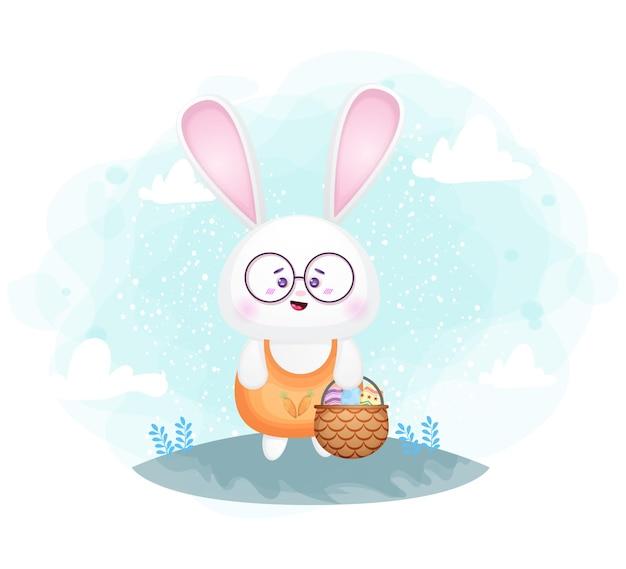 Милый кролик с пасхальным яйцом в корзине