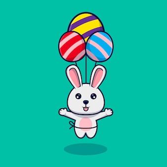 イースターエッグの風船で浮かぶかわいいウサギ