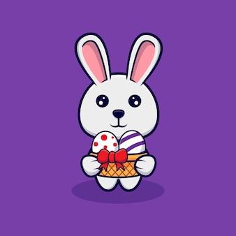 イースターの日のデザインアイコンイラストの装飾的な卵を保持しているかわいいウサギ