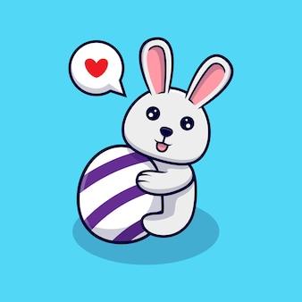 かわいいウサギはイースターの日に装飾的な卵を抱きしめます