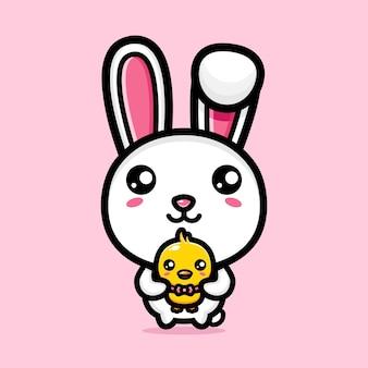 かわいいひよこを抱き締めるかわいいウサギ