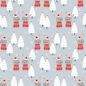 クリスマス冬のテーマのシームレスなパターンでかわいいウサギ