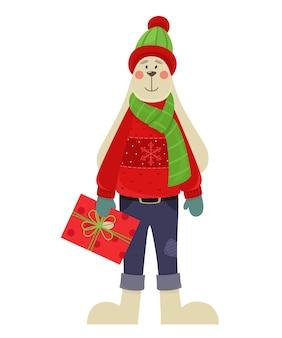 Милый зайчик в зимней одежде с подарком рождественский персонаж