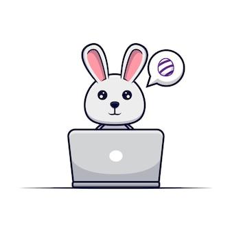 インターネットで装飾的な卵を探しているかわいいウサギ