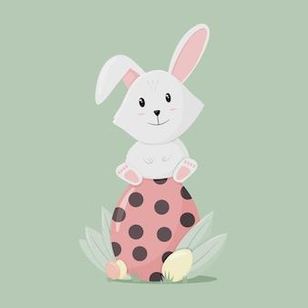パステルカラーの彼のイースターエッグのかわいいウサギ