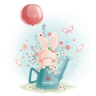 Cute bunny playing in the watercan