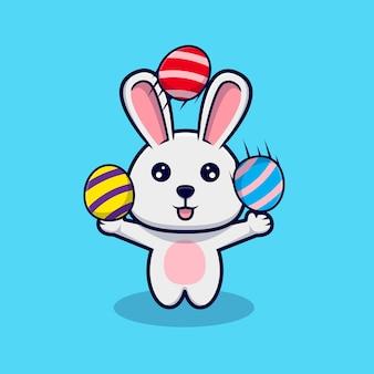 イースターの日に装飾的な卵で遊ぶかわいいウサギ