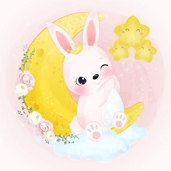 水彩画の効果で星のイラストで遊ぶかわいいウサギ