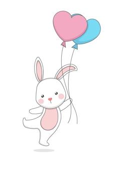 風船を持っているかわいいウサギのウサギ