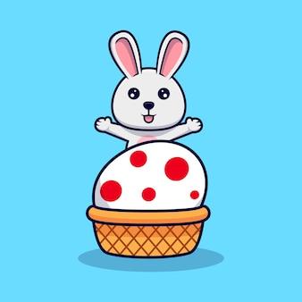 イースターの日のデザインアイコンイラストの装飾的な卵の後ろに手を振ってかわいいウサギ