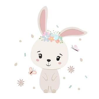 白で隔離の花輪とかわいいウサギ