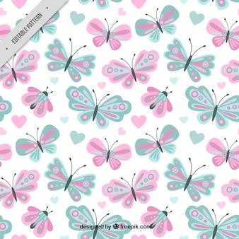 파스텔 색상의 귀여운 나비 패턴