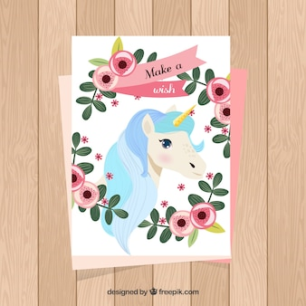 Cute card with unicorn and floral frame